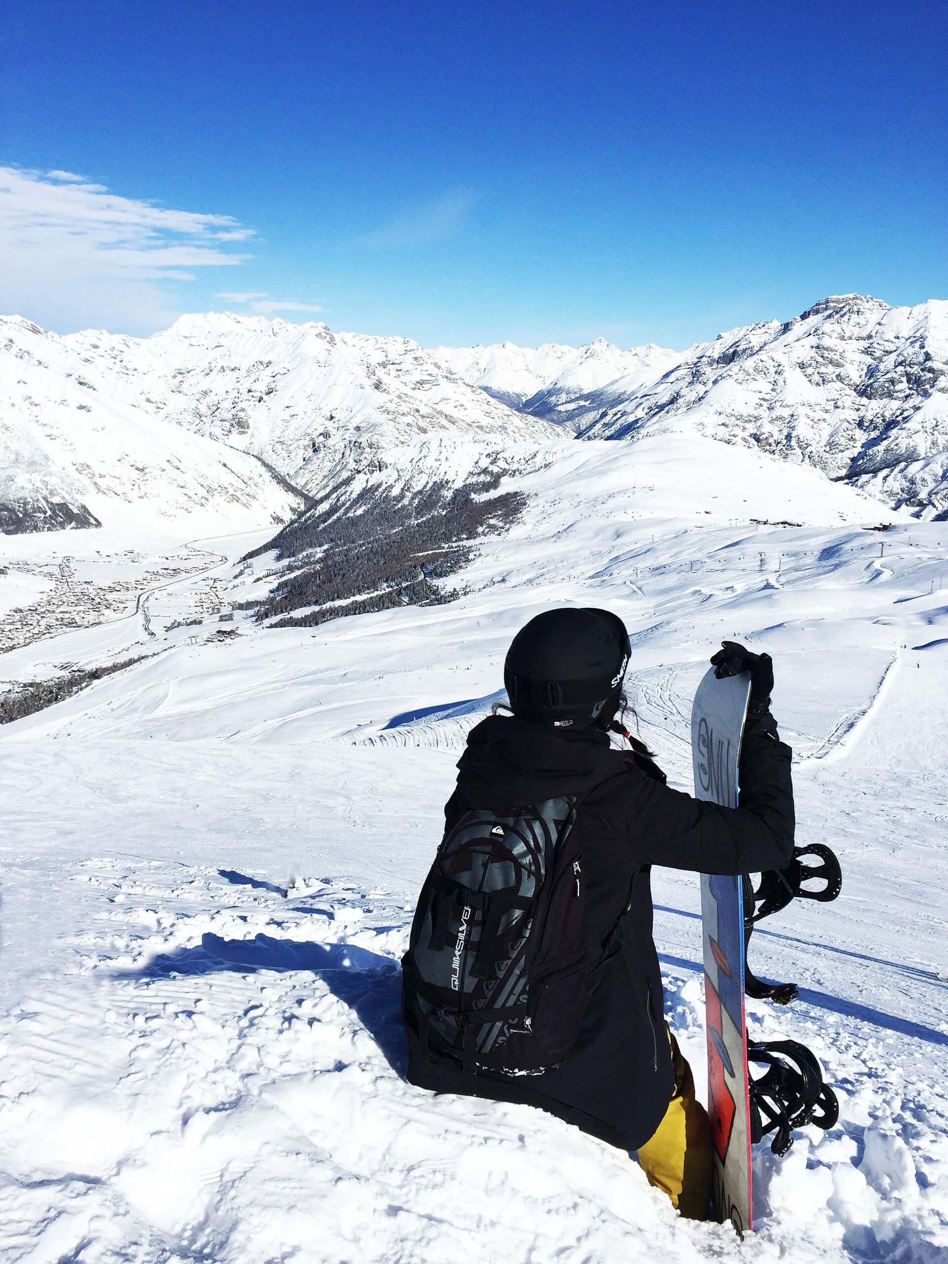 Na snowboard do Livigna